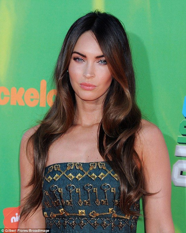 Mermaid locks: The Jennifer's Body starlet skipped the jewelry and wore sparkly eye-shadow...