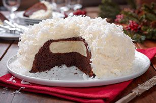 Snowball Cake Recipe - The classic lunchbox treat, this cake will bring back memories and bring up the question we all had as kids: how did the cream filling get in there - Kraft Recipes
