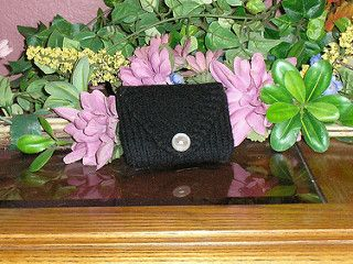 Summary: This project makes a small felted wallet with a single button closure. It can be made with leftovers from another project.