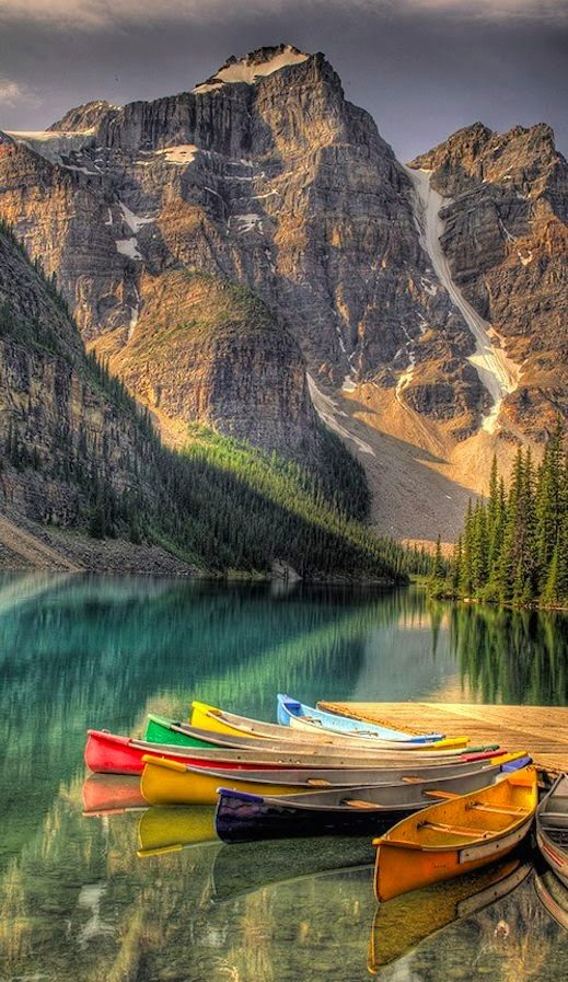 Colorful canoes on Moraine Lake at Banff National Park in the Canadian Rockies of Alberta, Canada