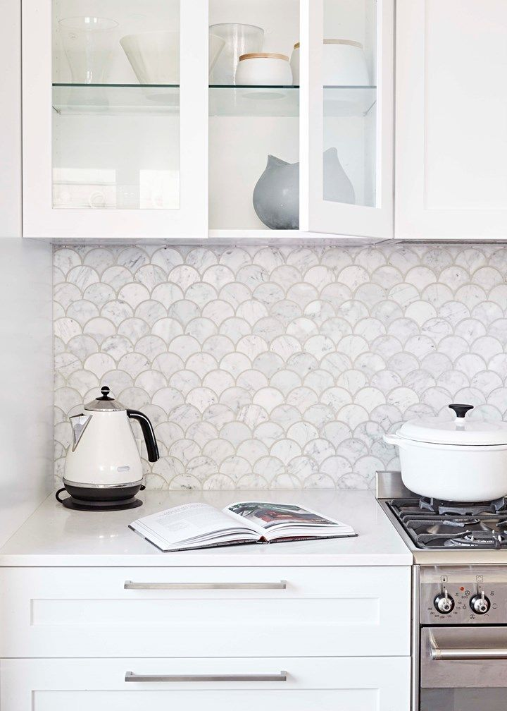 The Carrara marble tiles from Teranova for the splashback weren't cheap, but in a small space it's often possible to splurge on luxe finishes without costs blowing out.