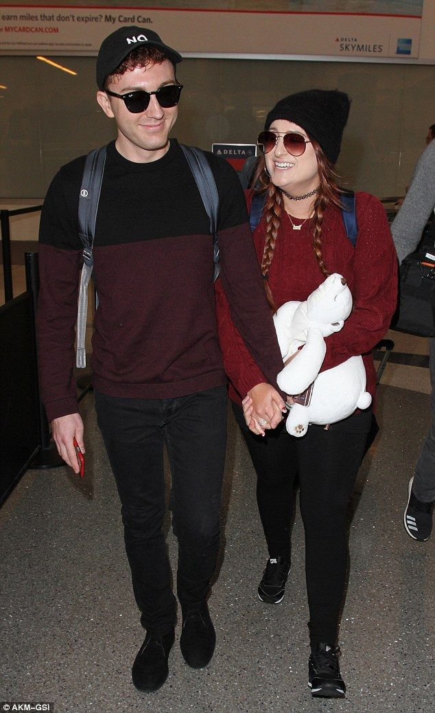 All about that face: Meghan Trainor had the look of love as she made her way through LAX Airport with actor boyfriend Daryl Sabara on Monday