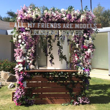 """The Zoe Report & Dolce Vita Pool Party: Flowers and vines covered a kissing booth photo station emblazoned with the message """"All my friends are models."""""""