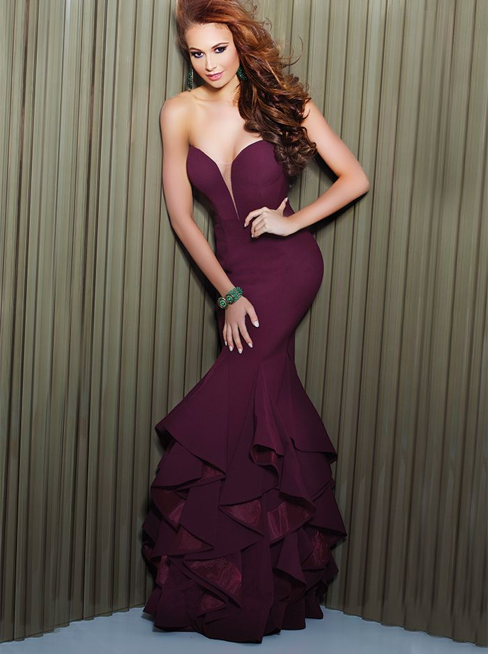 Simple, yet show stopping. The rich fabric and elegant ruffles on this GoForGlam Exclusive prom dress by Jovani say it all. Available in two of season's hottest colors, Burgundy and Lime, you're sure to fall in love with this romantic style the moment you put it on. This stunning Jovani style can only be found at authorized Cool Book retailers!