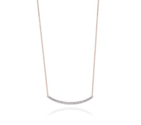 The curved line of diamonds in this delicate necklace is simple and gorgeous. Featuring pavé set diamonds totalling 0.22 carats, the necklace measures 18 inches and has a sliding bead to adjust its length. This piece looks beautifully understated alone or teamed with other Skinny designs.