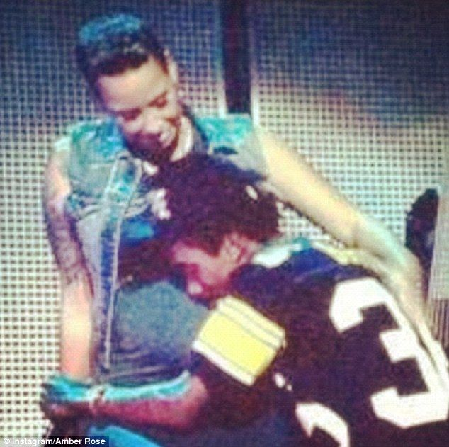 Wiz Khalifa hugs his fiancee Amber Rose around her pregnant belly during his concert . Cutest couple EVER!!!