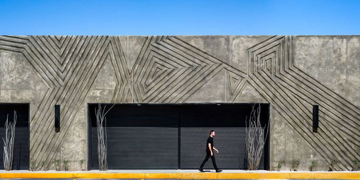 FIRM: Jorge Urias Studio;   PROJECT: Anapra.     Simple neighborhood commercial structure that has flexible interior configuration. The structure uses a recessed pattern of cast concrete panels to reflect the relationship between residents and the local surrounding.