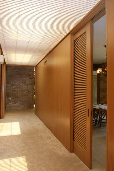 Louvered door used as a pocket door/ room divider