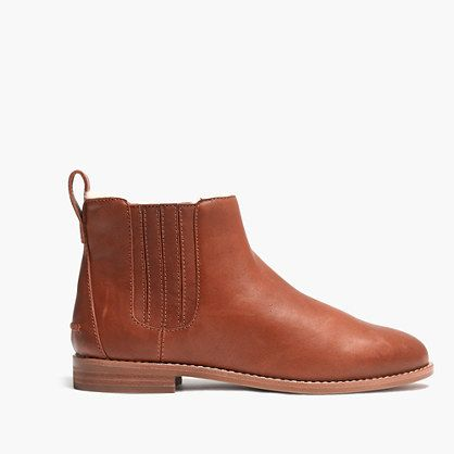 "In shearling-lined leather, this cozy take on a Chelsea boot is an instant classic (especially perfect on the chilliest of days). Please note: When you select your size, ""H"" equals a half size.  <ul><li>Leather upper.</li><li>Shearling lining.</li><li>4 7/10"" shaft height (based on size 7).</li><li>5"" shaft circumference (based on size 7).</li><li>3/5"" heel.</li><li>Man-made sole.</li><li>Import.</li></ul>"
