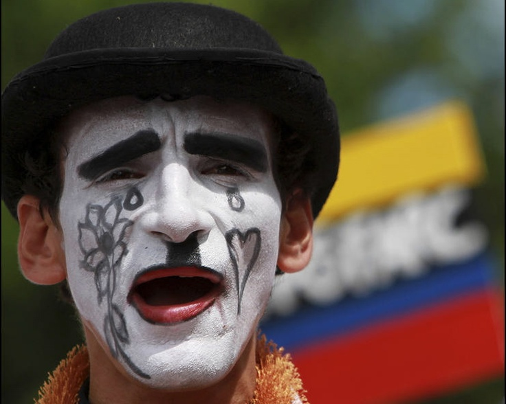 A man dressed as a mime takes part in a protest against violence and kidnappings in Cartagena, Colombia. Photo by Joaquin Sarmiento/Reuters