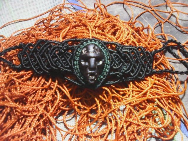 Macrame bracelet with carved oil palm seed