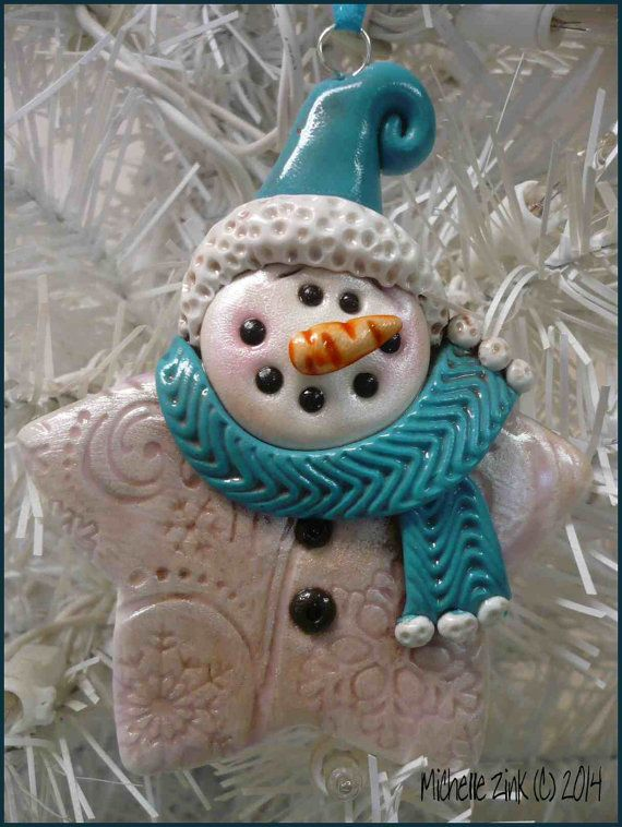 I made this ornament from polymer clay. He is stamped with snowflakes & then burnished with a platinum colored rub, brushed with a dark pearly