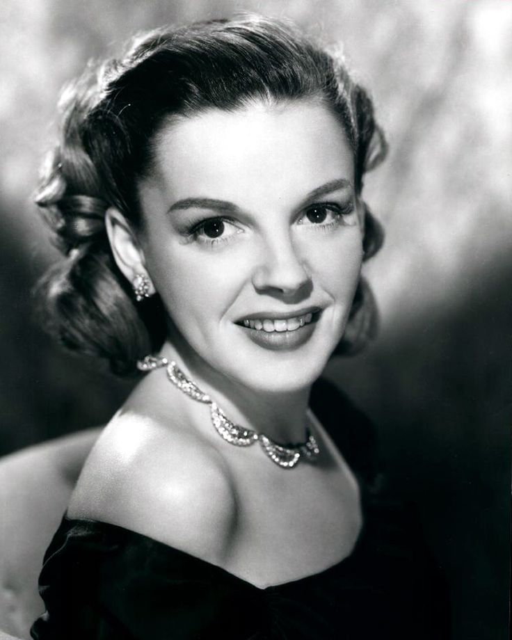 Judy Garland!  Not so much a big mouth, but her teeth were always kind of out there, weren't they?