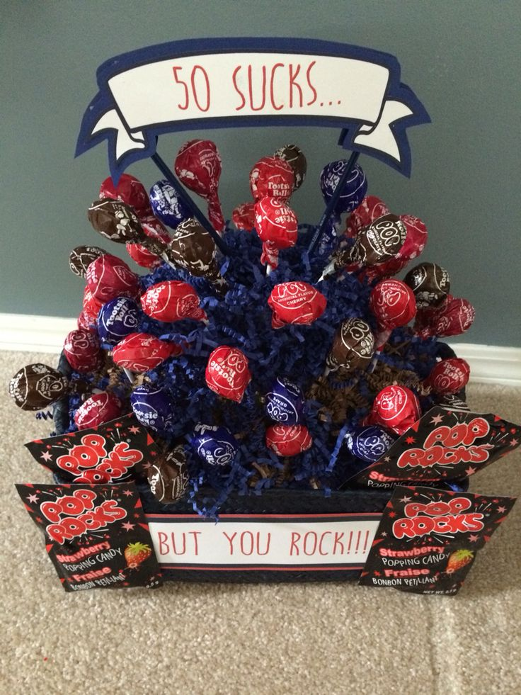 Birthday Bouquet.  50 sucks but you rock. Made with Tootsie Pops and Pop Rocks.