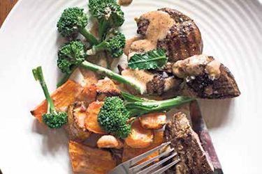 Lamb leg steaks with broccoli and almond butter