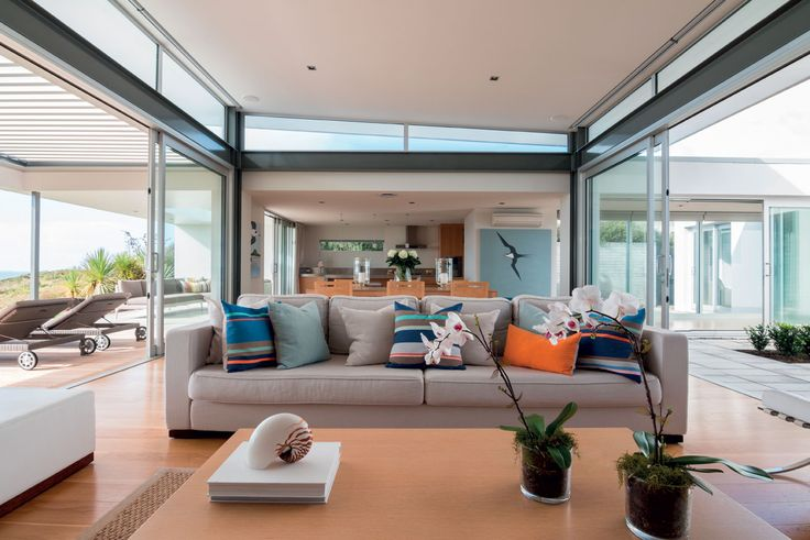 A high stud coupled with outdoor spaces on both sides give a sense of the living area being almost marquee-like.