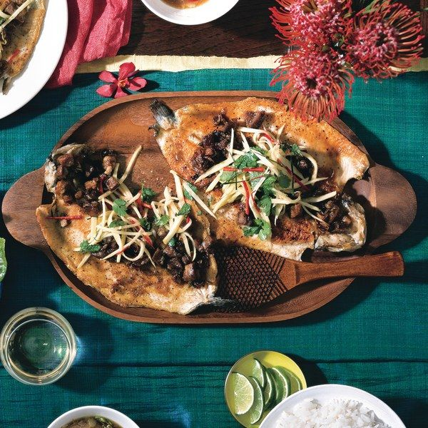 Surf-and-turf like you've         never had before—whole fried trout topped with crisp pieces of sweet and spicy pork. For a traditional Thai dinner, serve the mains and sides family-style         with a large bowl of steamed jasmine rice.