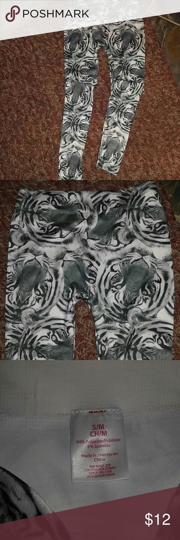 Lady's Tiger Print Leggings!! Super cute and sexy!! Black, white, & a bluish gray pair of stretchy leggings with tiger faces. New without tags. Size S/M. Unknown Pants Leggings