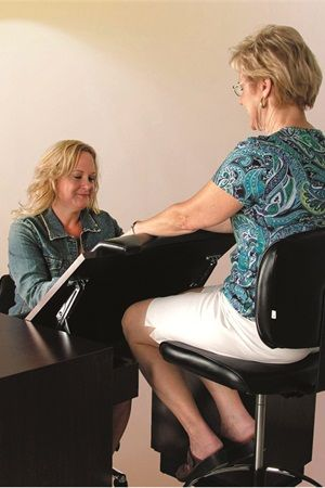 No More Looking Down - Health - NAILS Magazine - Westmond Salon Designs Founder Carrie Bomar, was featured in NAILS magazine for her invention, the 'Westmond Ergonomic by Collins.'