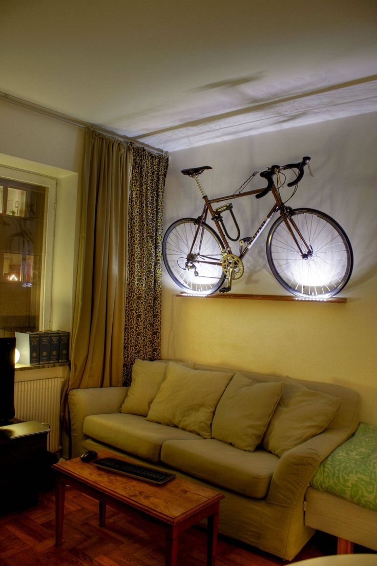 I don't know about hanging inside, but the idea of stacking angled bikes on a wall is something to explore