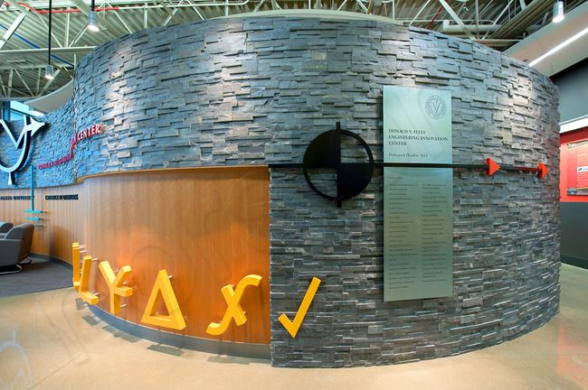 Curved Radius wall using  Norstone Stacked Stone Rock Panels - Charcoal