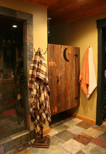 I like the idea of an outhouse type door for the front guest bathroom door., maybe with metal sheets behind the cutouts to maintain privacy.