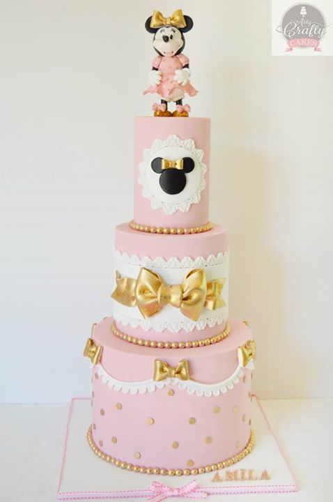 Pink and Gold Minnie Mouse first birthday party cake idea from Arty Crafty Cakes. Visit their FB page here: https://www.facebook.com/ArtyCraftyCakes/ For more ideas, visit A Pop of Party!