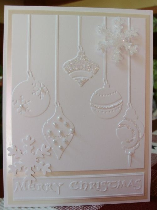 Embossed all white ornament Christmas card with pearls and ribbon. Elegant
