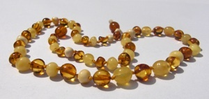 Amber Teething Necklace in Milk & Honey : http://www.naturebumz.com/hazel-aid-baltic-amber-teething.html