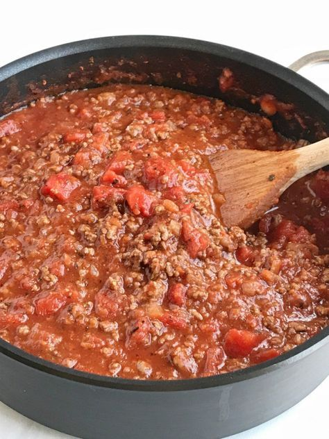 Ditch the canned spaghetti sauce for this flavorful, beefy, homemade spaghetti meat sauce. Only takes a few minutes  to prepare and then let it simmer for amazing flavor. Serve over pasta noodles with some garlic bread for a delicious dinner that will please everyone.