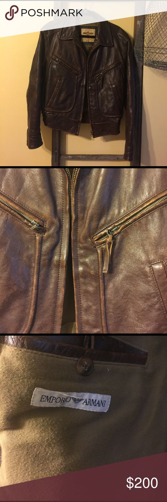 💙 Emporio Armani Leather Bomber 💙 Amazing Emporio Armani Leather Bomber in perfect shape, minus the missing leather pull on the left side zipper. Though the jacket states no size, it fits like a men's small or, perhaps, a woman's large. Not the jacket in second photo! Emporio Armani Jackets & Coats Bomber & Varsity