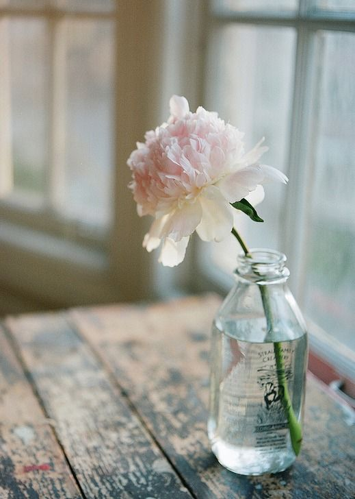 ahh, vintage bottle, pink white single stem flower and rustic weathered love...doesn't get much better huh?