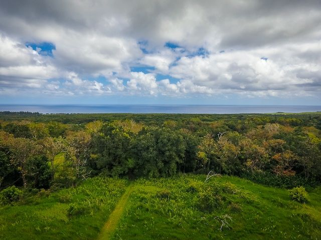 Two side by side 6 acre lots in Hana, Maui sold together. Offered for $655,000 by the Maui Real Estate Team, Inc.