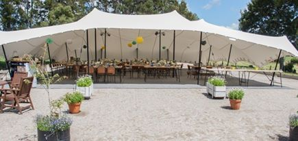 16m x 15m white Schupepe tent rigged on a horse equestrian arena for a vintage-style wedding 2015