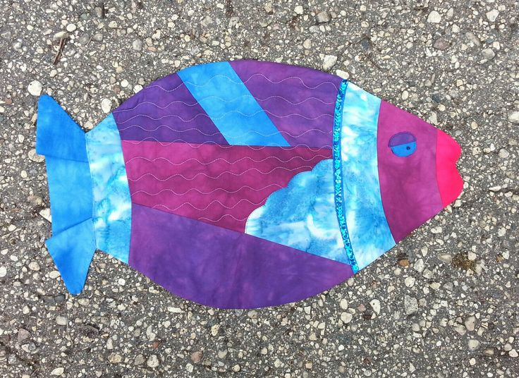 Damned Fishie.  Made with hand dyed fabrics, machine pieced & quilted.