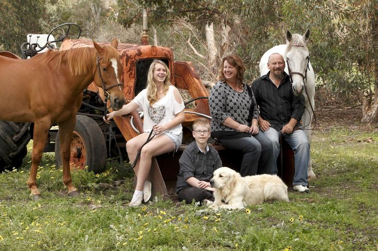 Family portrait sitting on a tractor, with two horses and a dog. Outdoor Family…