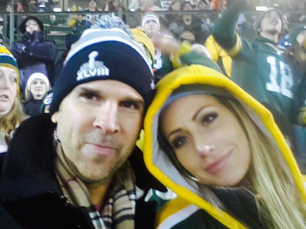 Erik Kuselias and Holly Sonders at a game