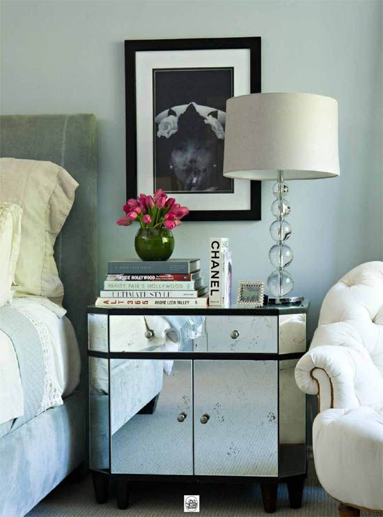love this mirrored side table placement of books and the lamp