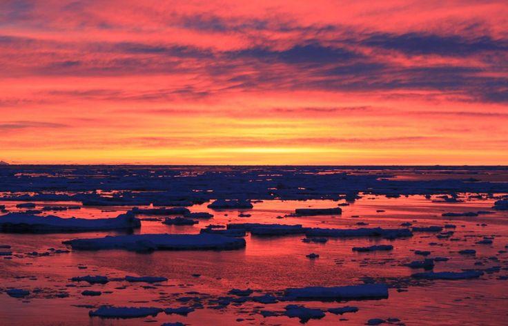 Antarctica: The sun sets at Palmer Station, Anvers Island, near the Antarctic Peninsula.