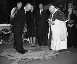 President Dwight Eisenhower and Pope John XXIII President Dwight D. Eisenhower walks with Pope John XXIII at the Vatican on December 6, 1959. (Credit: AP Photo/Paul Schutzer, File.)