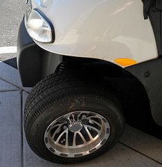 Custom EZGO golf cart accessories include new tires and wheels for a cart that reflects your style.