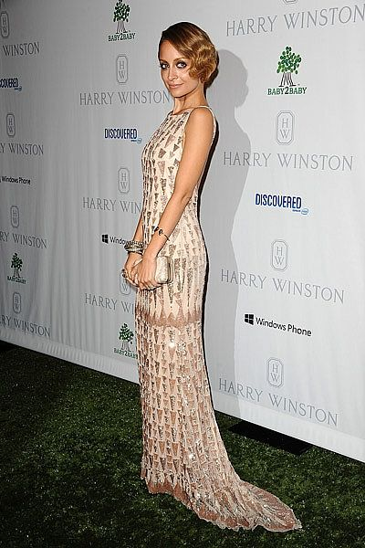 Nicole Richie oozed vintage glamour as she arrived for the Baby2Baby Gala in California this week.Dressed in an embellished nude-coloured fishtail gown from Lorena Sarbu and carrying a House of Harlow 1960 clutch, the mother-of-two finished her look with  retro-chic finger-waved hair and dark smoky eye make-up.