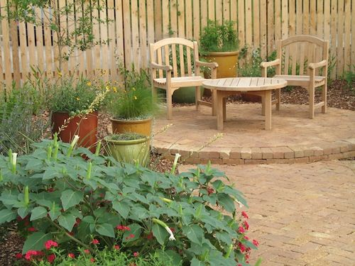 love using pots on patio and in the garden especially for herbs mixed with flowers