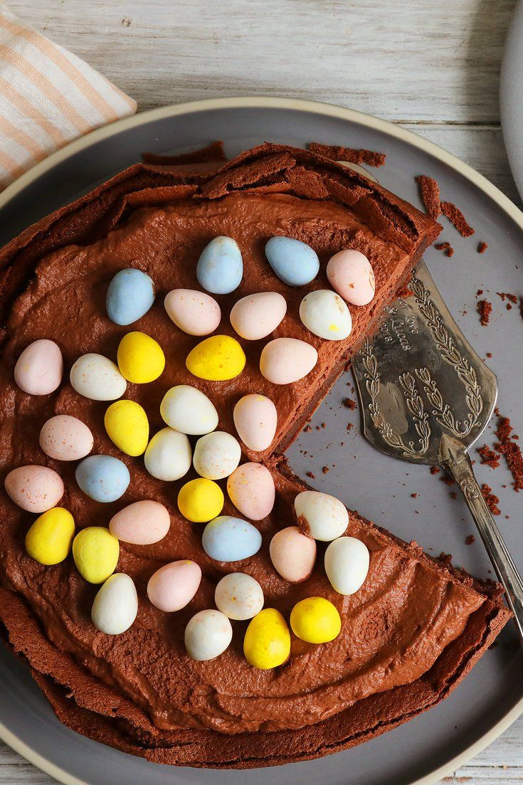 NYT Cooking: It is, I hope, the acceptable face of culinary cute: a chocolaty flourless cake that falls on cooling. The sides crack, forming the outside of the nest, and into the cake's sunken cavity you spread a soft, voluptuous mixture of whipped cream and melted chocolate. And on top of this you drop small, sugar-coated candy Easter eggs.<br/>It's ease itself — especially as you%2...
