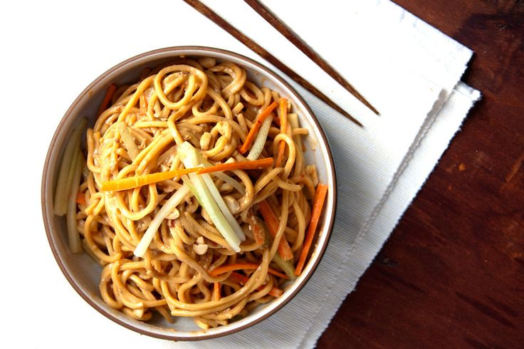 COLD SESAME NOODLES Peanut butter, sesame paste, and chile-garlic paste combine to make a silky, savory sauce for these noodles—a Chinese-American restaurant staple. Chopped peanuts and a flurry of slivered cucumber and carrot add crunch.