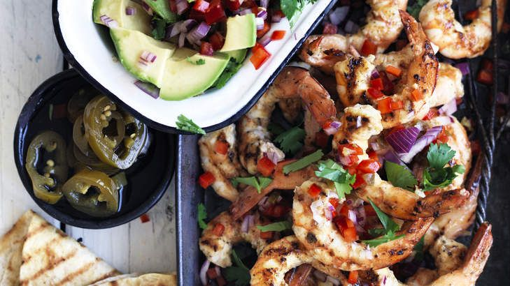 Yucatan-style grilled king prawns with avocado jalapeno salsa. Recipe here > http://www.goodfood.com.au/good-food/cook/recipe/yucatan-grilled-king-prawns-with-avocado-salsa-20151201-473yr.html