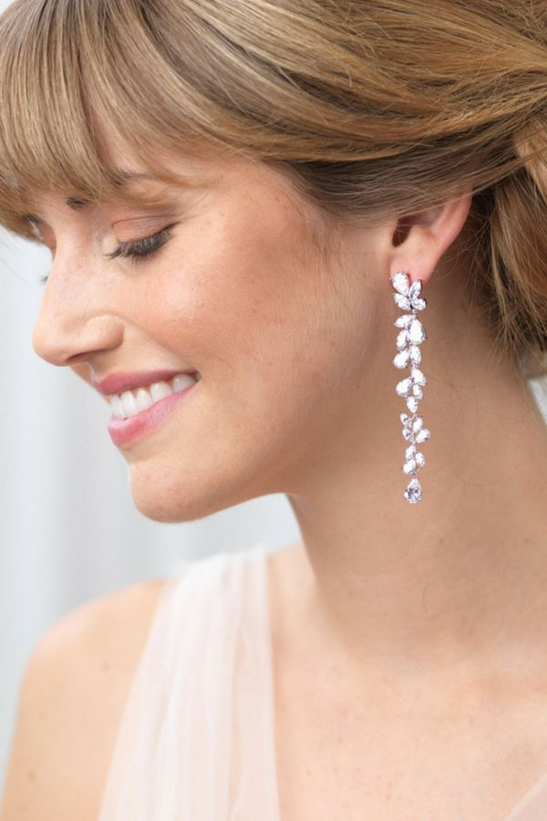 27686fe18 Bridal earrings feature a dramatic cluster drop of cubic zirconia  rhinestones and offer a sensational statement for your wedding day.