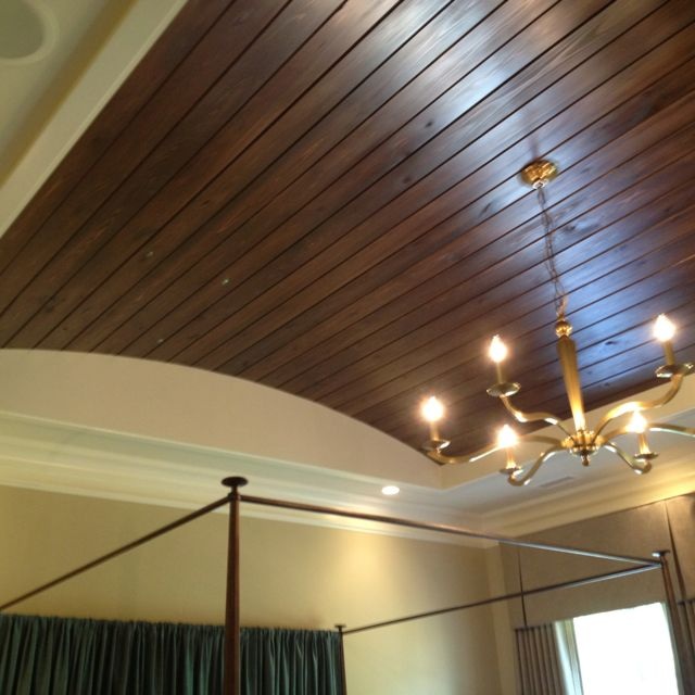 Tongue and groove wood flooring in trey ceiling. Very cool