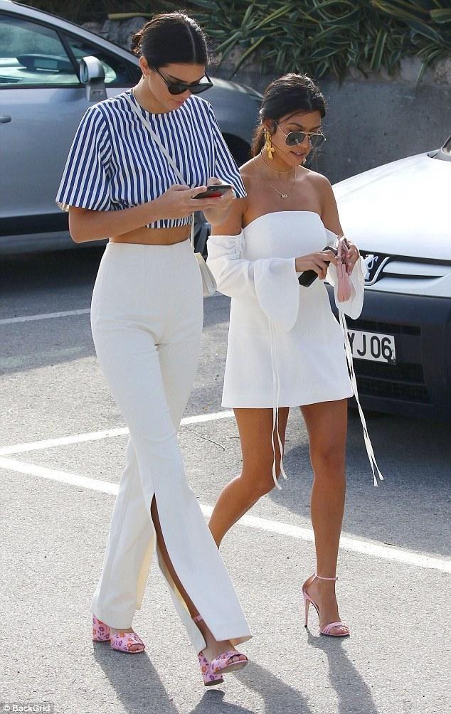 Kourtney Kardashian wearing Gucci Pink Patent Sandals, Fendi Mini Croissant Bag, Valere Jewellery Donatella Earrings and Saint Laurent Classic Aviator 11 Sunglasses
