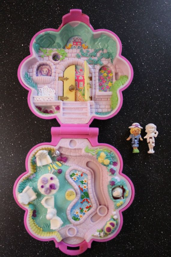 """Polly Pocket - Garden Surprise (1990) Back when Polly actually fit in your pocket. And no one had to tell us, """"Don't choke on Polly Pocket,"""" because we weren't stupid enough to eat her."""